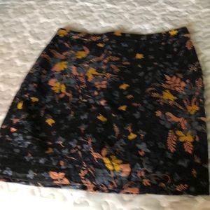 LOFT slim floral skirt. Never worn. Fully- lined